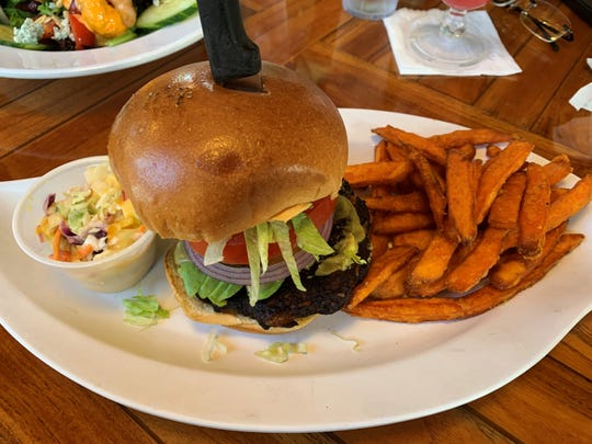 The veggie and black bean burger with cole slaw and sweet potato fries  from Mango's Dockside Bistro, Marco Island.