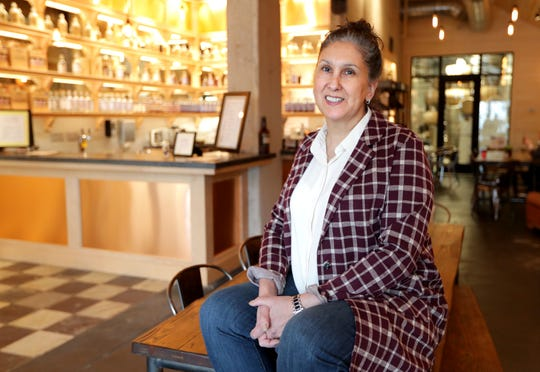 Mary-Kay Bourbulas, pictured, and Lisa Tank own Handen Distillery in Cedarburg.