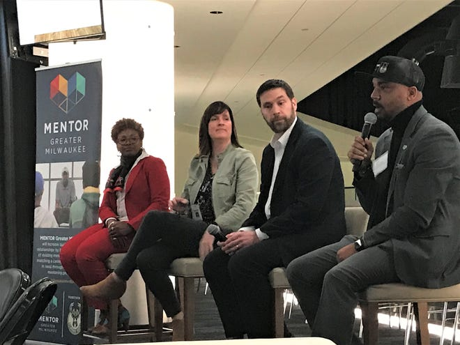 From left to right: Darice Brown, a global supply chain messaging and communications manager from Rockwell Automation; Kelly Kauffman, chief human capital officer at the Milwaukee Bucks; Thomas Rosenthal, a program officer from Northwestern Mutual; and Lanelle Ramey, the executive director of Mentor Greater Milwaukee.