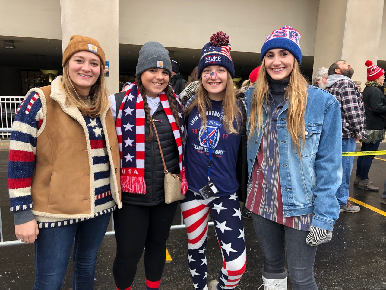 From left, Sarah Kuch, Julia Ulik, Shiloh Kazarovich and Susannah Kuch, all of Neosho, were decked out in American flag-themed clothes for President Donald Trump's rally in Milwaukee on Jan. 14, 2020.