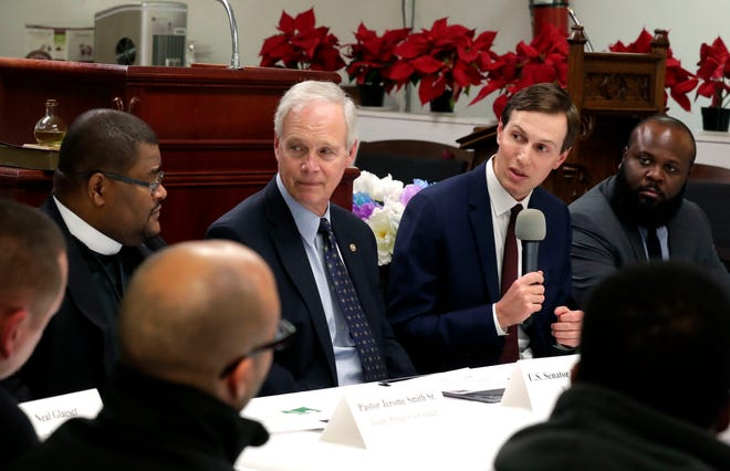 Jared Kushner, third from left, a senior adviser and son-in-law to President Donald Trump, joins U.S. Sen. Ron Johnson, Pastor Jerome Smith of Greater Praise Church of God In Christ and Deputy Assistant to the President Ja'Ron Smith, far right, as they discuss the Joseph Project, a jobs initiative to link inner-city workers from Milwaukee to jobs, during a roundtable at the church on Tuesday.