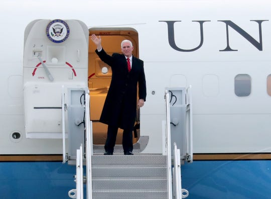 Vice President Mike Pence waves as he arrives at the 128th Air Refueling Wing near Milwaukee Mitchell International Airport on Air Force Two before President Donald Trump was to hold a campaign rally at UW-Milwaukee Panther Arena in Milwaukee Jan. 14, 2019. Pence was expected to attend the rally with the president.