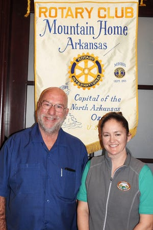 On Thursday, Jan. 9, the Rotary Club of Mountain Home hosted a program from the Arkansas Game & Fish Commission. Rotary board member Scott Sillence, owner of Gene's Trout Fishing Resort, introduced guest speaker Christy Graham, Trout Management Supervisor with AGFC. Graham spoke to the club about the economic impact of trout fishing in North Arkansas, trends and rules for trout fishing, the local fish hatchery services, and the future projects of the commission in our area. Club President Kriss Yunker announced two proposed new members, then thanked Jay Chafin for volunteering to coordinate the Dictionary Delivery to third-graders in Mountain Home, Cotter, Norfork, and Calico Rock schools, plus the Mountain Home Christian Academy. Pictured above is Rotary Program Chair Scott Sillence and Christy Graham, AGFC Trout Management Supervisor.