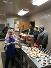 Volunteers from First United Methodist Church who are part of the Wesley Kitchen Ministry serve dinner on Thursday night. Various groups offer meals throughout the week around Mountain Home.