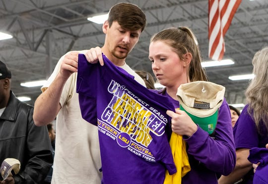 Louisiana State University fans waited for the end of the College Football National Championship game in line outside Academy Sports & Outdoors in West Monroe, La. to be some of the first to purchase championship merchandise after LSU's win over Clemson on Jan. 13.