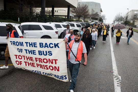 The Ordinary People Society march from the Alabama Department of Corrections to the Alabama State House in Montgomery, Ala., on Tuesday, Jan. 14, 2020.