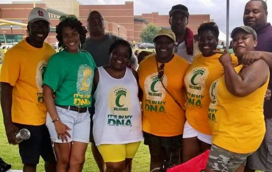 Orangeal White poses with friends from the Carver High Class of 1995. White was fatally shot Feb. 2, 2019 in Montgomery, Ala.
