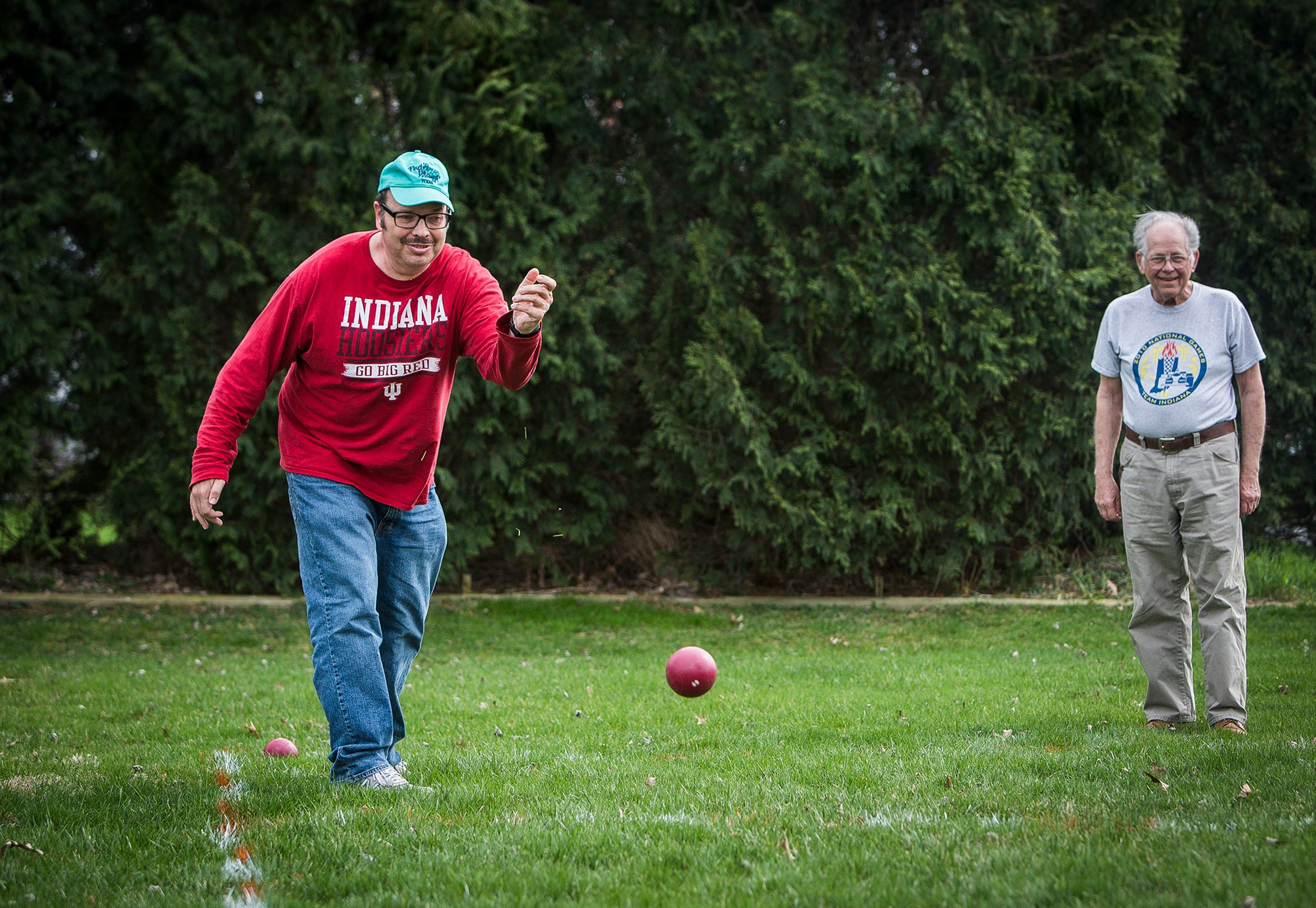 Jim Benadaum plays Bocci Ball with his father. In addition to being involved in self advocacy, Benadaum is heavily involved in the Special Olympics.