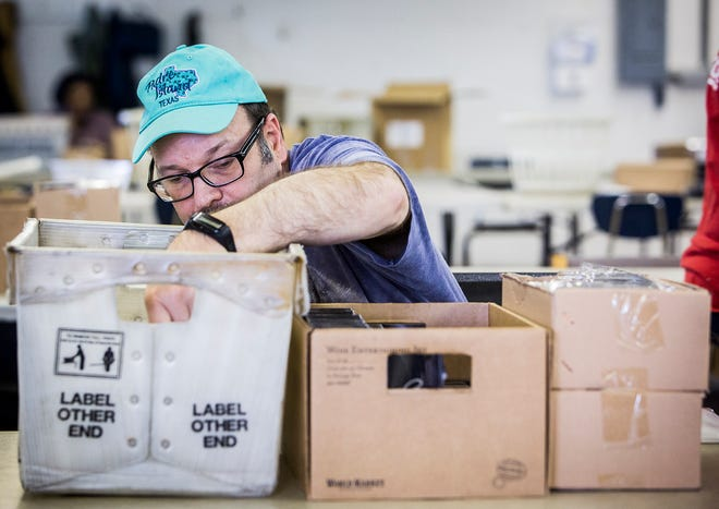 Jim Benadum puts together marketing packages for a company at Hillcroft Services. Benadum  has been doing assembly style work for more than 20 years.