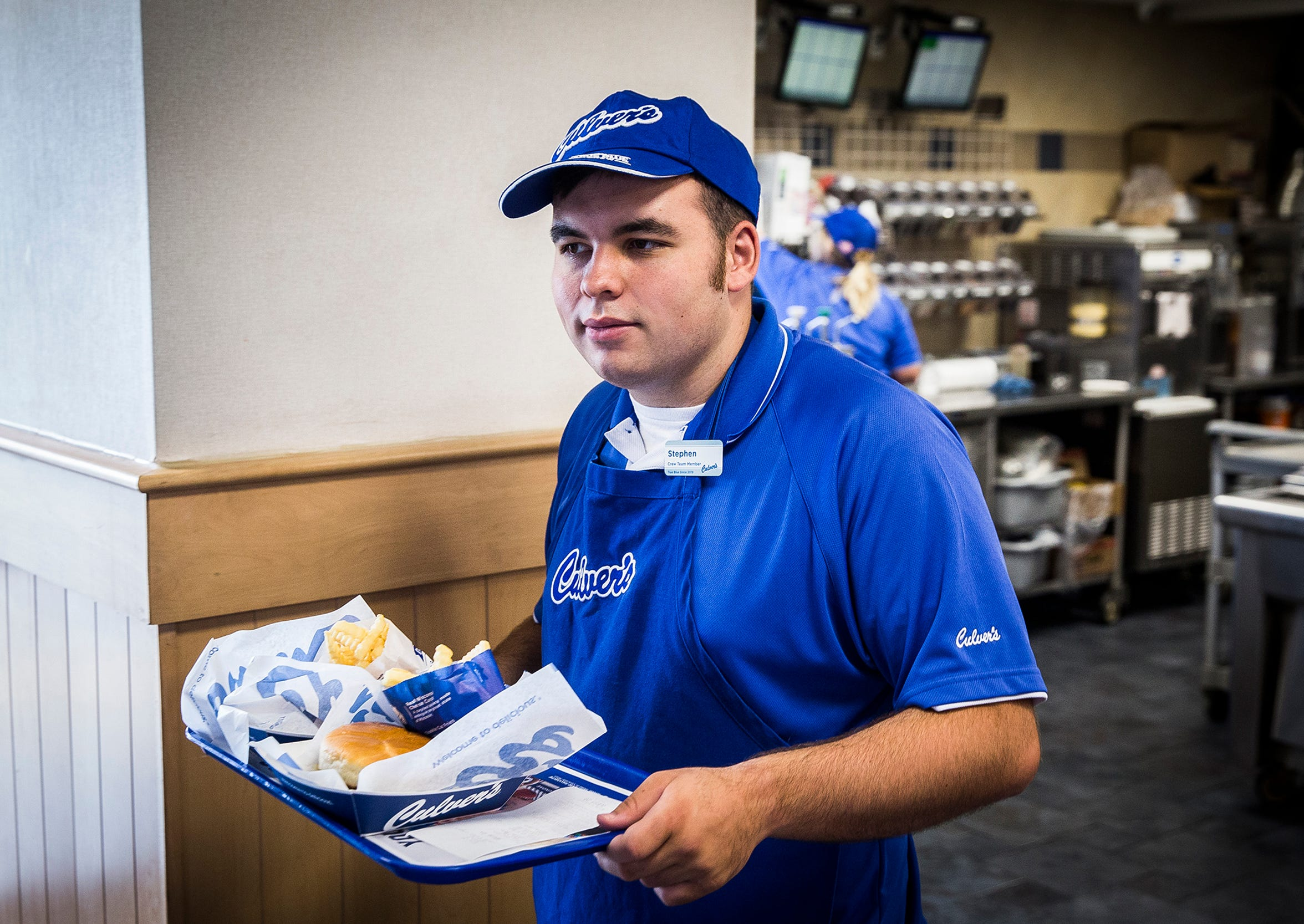Stephen Drake brings food to customers at Culver's on McGalliard Road. Drake completed training at the Erskine Green Institute before finding placement in several service industry jobs.