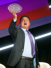 Ed Orgeron, coach of LSU's football team, receives the Amway Coaches Poll championship trophy during The American Football Coaches Association Awards Ceremony held at Opryland Tuesday, January 14, 2020.
