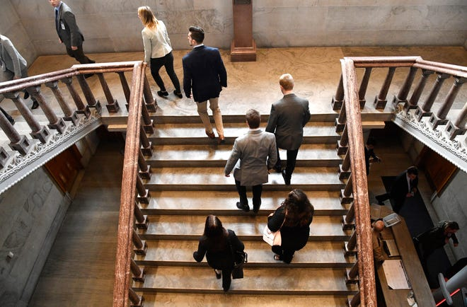People take the stairs to get to their seats before the first day of the state legislature in Nashville, Tenn. on Tuesday, Jan. 14, 2020.