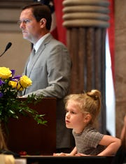 Greer Sexton stays close to her father House Speaker Cameron Sexton as he begins his first day as speaker in Nashville, Tenn. on Tuesday, Jan. 14, 2020.