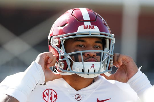 Alabama quarterback Tua Tagovailoa (13) adjusts his helmet before the first half of an NCAA college football game against Mississippi State in Starkville, Miss., Saturday, Nov. 16, 2019. Tagovailoa was injured in the second quarter. Alabama won 38-7.