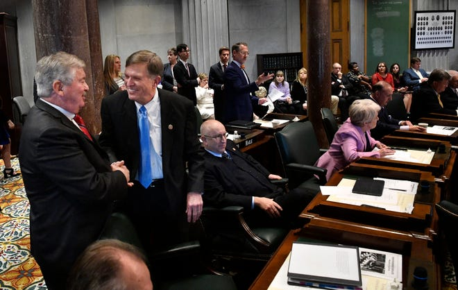 Lt. Gov. Randy McNally, R-Oak Ridge, congratulates Sen. Paul Rose, R-Covington, after his bill in the Senate passed allowing adoption agencies to deny same-sex couples adoptions during the first day of the state legislature on Tuesday, Jan. 14, 2020.