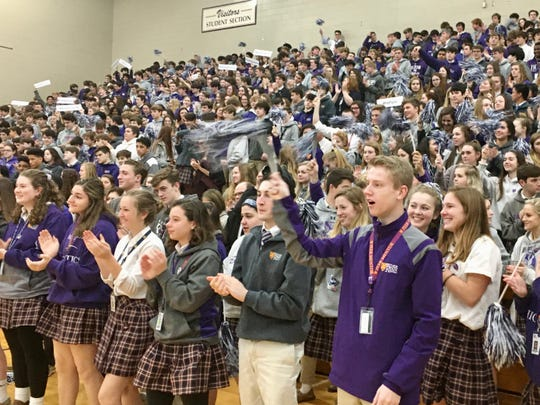 Father Ryan high school students give a standing ovation Jan. 14, 2020, after American Cancer Society execs present the school with an award for raising $1.2 million in 10 years to battle cancer