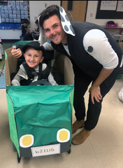 """Eli, playing doc catcher, with instructor Jake Toy during a class Halloween costume event built around """"101 Dalmatians."""""""