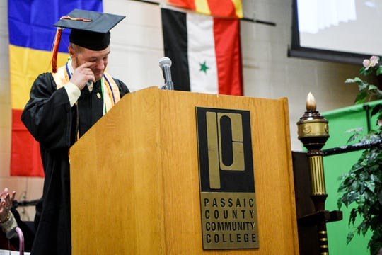 Salutatorian Casey Bucceri gets emotional as he speaks during the first Passaic County Community College winter graduation in Paterson on Tuesday January 14, 2020.