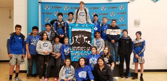 The Carlsbad Cavemen and Cavegirls pose after the Conflict at Cleveland on Jan. 11, 2020. Mason Box holds the second place banner. The Carlsbad Cavemen took second place while the Cavegirls took third place in girls tournament.
