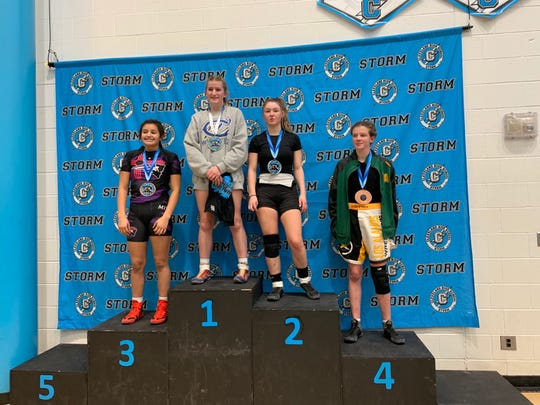 Carlsbad's Cady Box stand atop the podium after winning the girls' 126-pound division at the Conflict at Cleveland on Jan. 11, 2020. The Carlsbad Cavegirls took third place overall in the tournament.