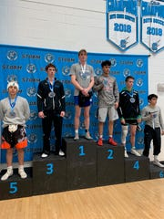 Carlsbad's Mason Box stand atop the podium after winning the boys' 152-pound division at the Conflict at Cleveland on Jan. 11, 2020. The Carlsbad Cavemen took second place overall in the tournament.