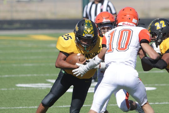 Newcomb's Deontay Begay, seen here playing against Lordsburg on Saturday, Sept. 21, 2019 at Skyhawk Stadium in Newcomb, is among five Skyhawk football players selected for the 2020 North versus South small-school All Star game.