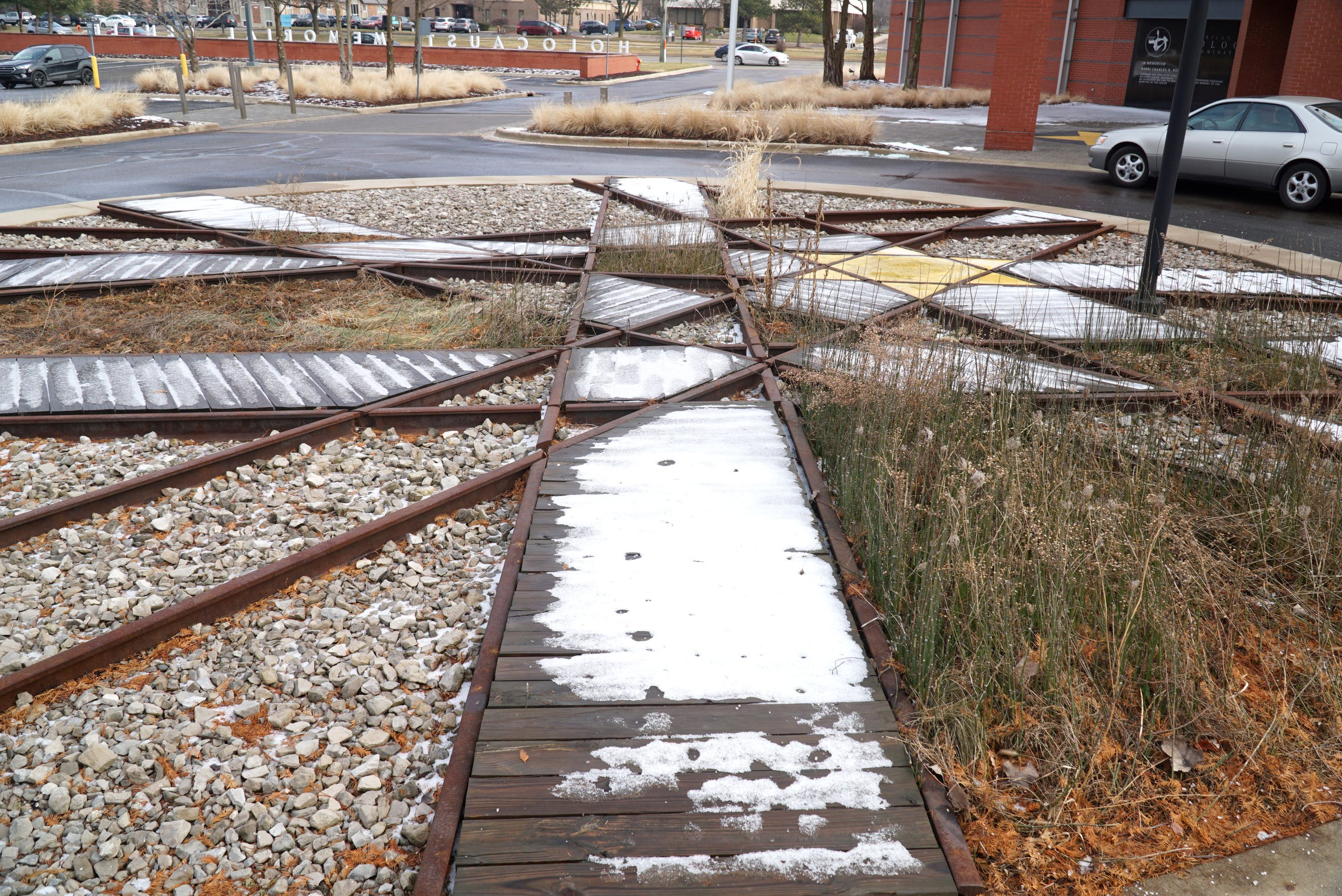 Outside the Holocaust Memorial Center in Farmington Hills is a small landscape of interscrossing railroad lines - with a small yellow Star of David at right. Jews and other concentration camp inmates were sent to places like Auschwitz on trains and while in ghettos were forced to wear a Star of David on their clothes.