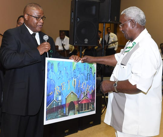 The Rev. Harry Richard, right, at a benefit for the churches destroyed by arson in 2018. Richard died Saturday, Jan. 11, 2019.