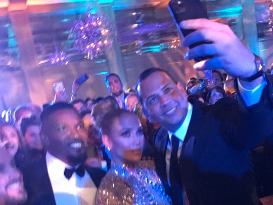 Unnecessarily tall columnist Shad Powers pops up in background of this photo of Jamie Foxx, Jennifer Lopez and Alex Rodriguez at the Palm Springs International Film Fest after part at the Parker.