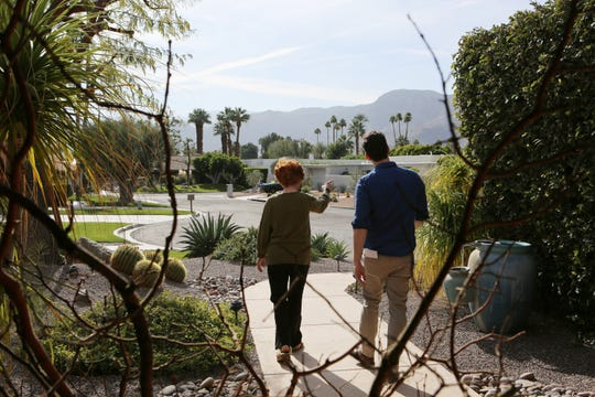 A resident on Camellia Court in Rancho Mirage gestures Tuesday as she talks to Desert Sun reporter Christopher Damien about burglaries that occurred on her block.