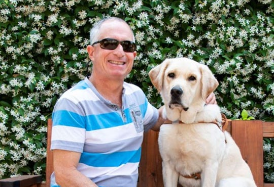 Dror Carmelli and his guide dog, Nero, will be honored at Israel Guide Dog Center for the Blind's 10th anniversary luncheon on Feb. 19.