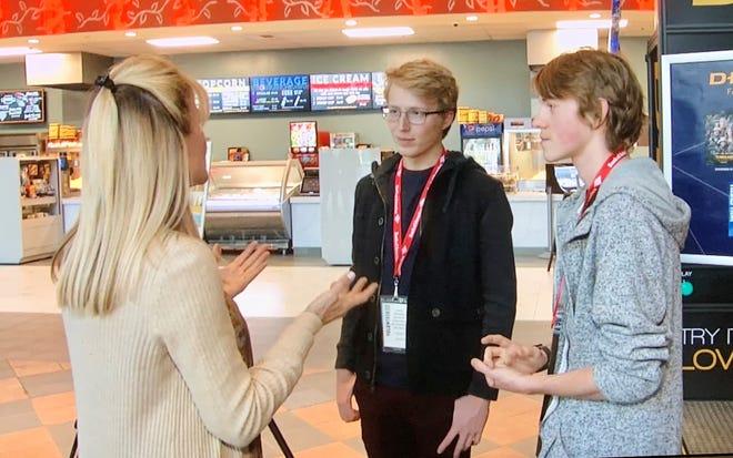Sandie Newton speaks to youth jury members Stefan Pejovic and Graham Bennett.