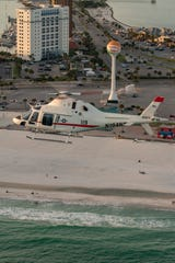 A TH-73A helicopter flies over Pensacola Beach. The new helicopters will replace old training helicopters at NAS Whiting Field.