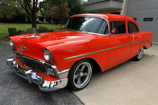 This Chevy's exterior is finished in custom tangerine paint, with disc brakes, a custom black interior and 18-inch wheels.