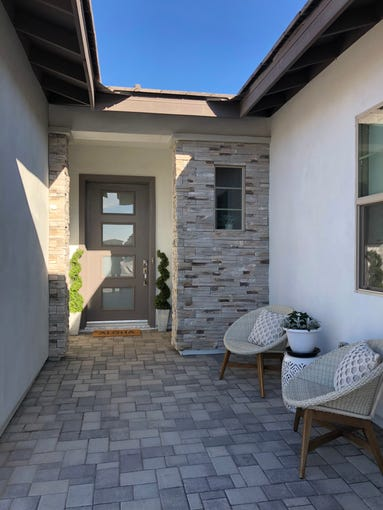 This cozy nook welcomes guests as they approach the front door to Laurie and Ryan Reber's new home at Inspire at Recker Pointe by Shea Homes in Gilbert.
