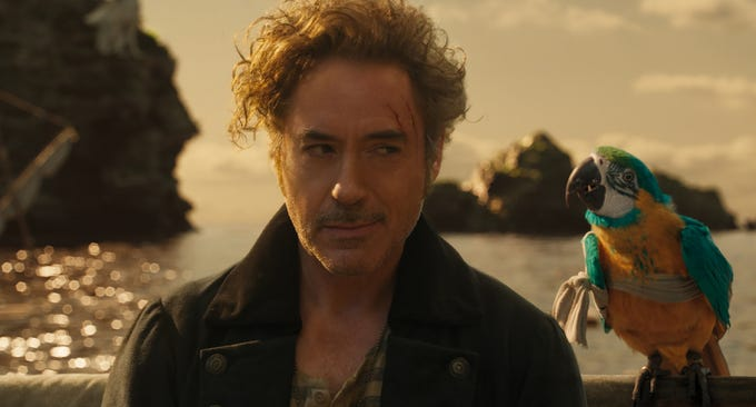 "Dr. John Dolittle (Robert Downey Jr.) and parrot Polynesia (Emma Thompson) in ""Dolittle,"" directed by Stephen Gaghan."
