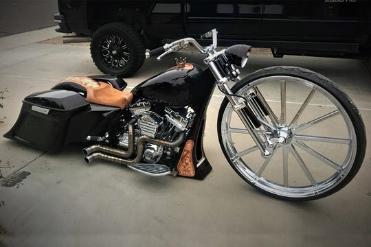 This motorcycle comes with front and rear air-ride suspension, HID lighting, Titanium exhaust and a custom 32-inch front wheel.