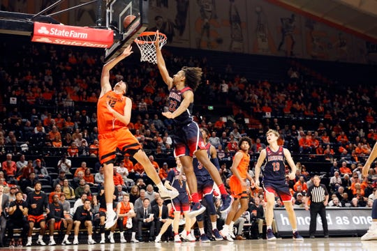 Oregon State Beavers center Roman Silva (12) shoots the ball past Arizona Wildcats forward Zeke Nnaji (22) during the second half at Gill Coliseum.