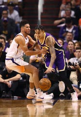 Los Angeles Lakers forward Kyle Kuzma (right) against Phoenix Suns guard Devin Booker in the second half at Talking Stick Resort Arena earlier this season.