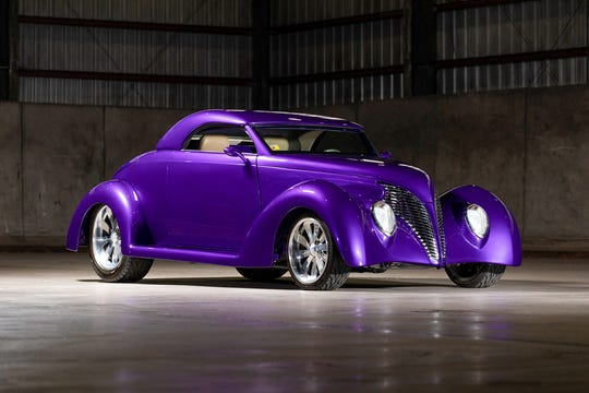 This 1933 Ford custom convertible was professionally built and is finished in Violet Pearl Metallic with pearl ghost flames on the hood.