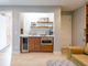 When renovating, Sons created a space that is sustainable and able to be locked off for guests or short-term renters. The room includes a kitchenette and a murphy bed.