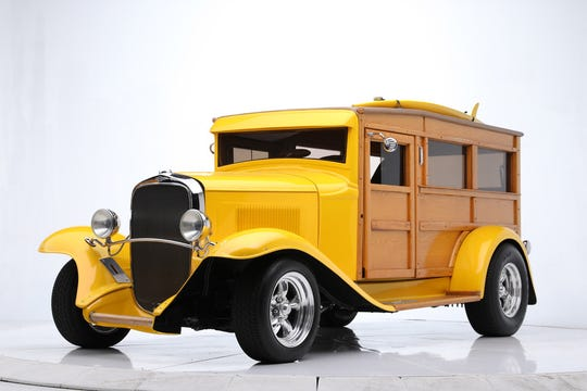 This 1932 Chevrolet custom woody wagon is named Lulu. The wagon comes witha surfboard and custom matching trailer.