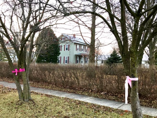 Missing teen Harley Dilly's body was found Monday in this vacant house across the street from the Dilly's home in the 500 block of 5th Street in Port Clinton. Bright pink ribbons, the teen's favorite color, lined nearly all of 5th Street on Tuesday.