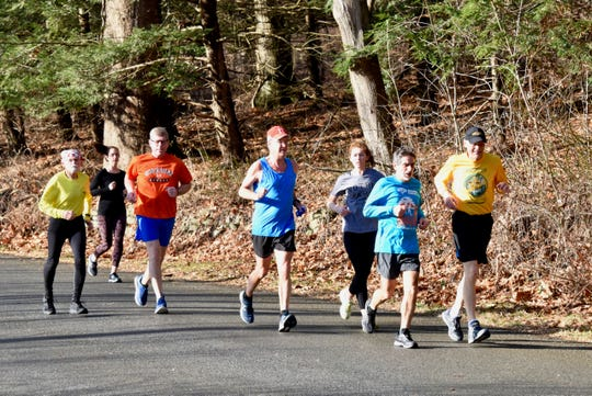 Runners enjoy an unseasonably warm Recover From the Holidays 50K race in Staatsburg on Sunday.