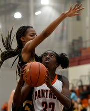 Central York's Mackenzie Wright-Rawls looks to shoot while covered by Red Lion's Makiah Shaw earlier this season. Central leads York-Adams Division I at 10-1. Red Lion is second at 10-2. Central can clinch the outright division title with a win Monday vs. Spring Grove.