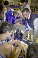 Dallastown coach Jay Rexroth, center, talks strategy during a 2001 boys' game against York High. Rexroth led the boys' program from 1993 to 2009.