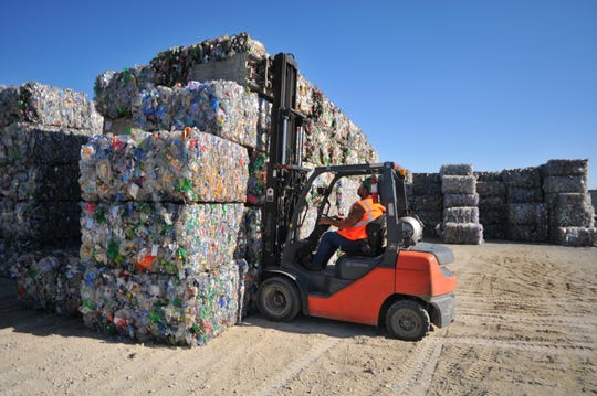 Bales of plastic bottles that will be converted to flake to be reused sit outside of DAK Americas at 1561 N.W. 11th St. in Richmond.