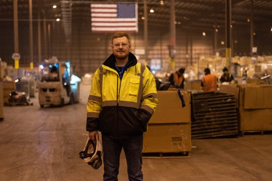 Matt Plummer, director of operations at Sunnking, stands in the middle of the electronics recycler's 204,000-square-foot facility in Brockport, New York.