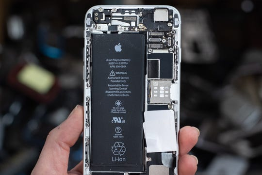 """An iPhone with a lithium ion battery has been disassembled at the Sunnking facility in Brockport, New York. A warning on the battery reads, """"Potential for fire or burning. Do not disassemble, puncture, crush, heat, or burn."""" Lithium ion batteries must be carefully removed from discarded electronics because if damaged, an electrical short can start a fire."""