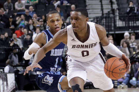 St. Bonaventure's Kyle Lofton (0) drives past Rhode Island's Fatts Russell during the first half of an NCAA college basketball game in semifinal round of the Atlantic 10 men's tournament Saturday, March 16, 2019, in New York.  St. Bonaventure  plays UMass in Rochester on Wednesday night.